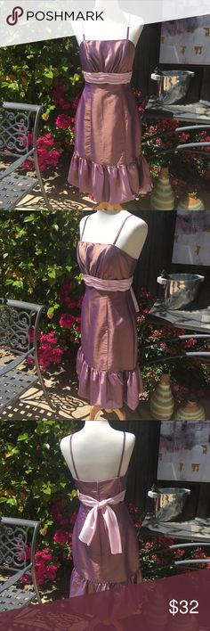 🎉New!🎉 Pretty Lavender Iridescent Dress EUC! This is a feminine and flirty like-new, possibly never worn special occasion dress!! Size 10. It is party season now! 💖 This dress has several amazing features... Spaghetti straps that are removable-with-snaps (last pic). That means it converts to completely strapless beauty! Also, a pretty balloon hemline for the striking flounce and lines of this dress. Fully-lined. Soft pink sash belt adds a pretty touch. Enjoy! 💜🌸🎉 Impression Dresses