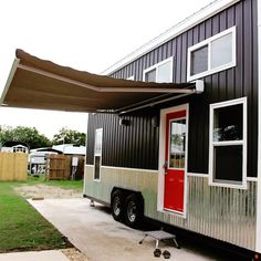 A 192 square feet tiny house with electric awning built by Mini Mansions Tiny Homes Builders in St. Louis, Missouri.
