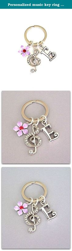 "Personalized music key ring with rhinestone treble clef charm, purple flower, and initial charm, unisex keychain gift for musician. Beautiful and practical personalized music key ring, with a treble clef studded with rhinestones, purple flower, and personalized initial. The charms have amazing detail! I've attached them to a silvertone iron key ring measuring just under 1"" in diameter (24mm). The treble clef charm measures 1 1/8"" tall and 5/8"" wide (28x16mm). Perfect for the musician or..."