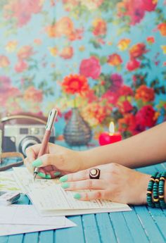 Turquoise and bright flowery boho wallpaper.