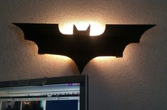 Nerd Craft fit for Gotham City: DIY Batman Bat Signal Lamp Light. Looks easy! Cardboard or card stock or wood, paint and an LED light fixture. POW! BAM! Perfect.