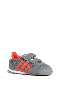 Free shipping and returns on adidas 'Dragon' Sneaker (Baby, Walker & Toddler) at Nordstrom.com. He'll look retro-cool in a '70s-inspired running shoe with signature triple stripes racing down each side. Adjustable hook-and-loop straps make for a secure fit that's easy to adjust.