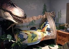Dinosaur themed room.  I think this child would be sleeping in the belly of the beast!