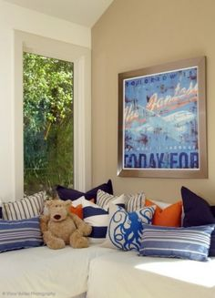 blue and orange accents with wall color... Love the sand and blue combo with a pop of orange... navy and orange... Like the color combo of pillows ! Blues w oranges... different colors of blue mixed in with orange... color scheme for room -blue,orange, navy,tan...