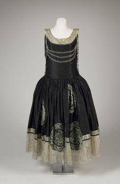 "Evening dress ""Veilleur de Nuit"" Designer: Jeanne Lanvin Date: ca. 1924 Media: Taffeta, Lace, Pearls, Beads, Sequins, Mirror Discs Country: France Accession Number: 1981.53.1"