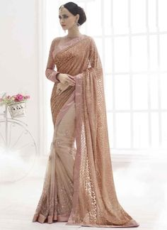 Almond color glitter velvet embossing net party wear saree http://www.angelnx.com/Sarees/Party-Wear-Sarees