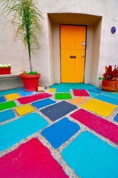 I'm just fascinated by color as evidenced by my entire board :) The bold hues in these patio tiles are just so amazing and unexpected! And the bright orange door, unreal. Crazy cool image.                                                  fun !