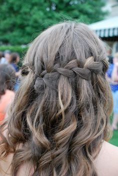 This is a very popular hairstyle right now, and this looked great for prom. I curled her entire head of hair, then just gently braided the back, allowing parts of the braid to fall out. Great hairstyle to choose if wearing a strapless dress!