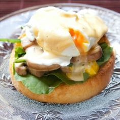 A healthy twist to Eggs Benedict using muffins, spinach, mushrooms, a perfect poached egg and hollandaise