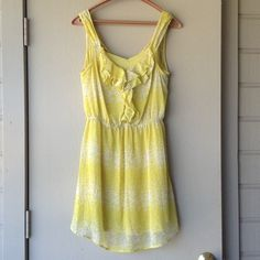 LC Lauren Conrad Yellow Ruffle Dress This adorable yellow dress features ruffles on the bodice and teeny tiny white butterflies. Light weight chiffon material keeps this dress cool and flowy. Includes a yellow slip to go under the dress. Wore once for a summer reunion. From smoke free home. LC Lauren Conrad Dresses Mini