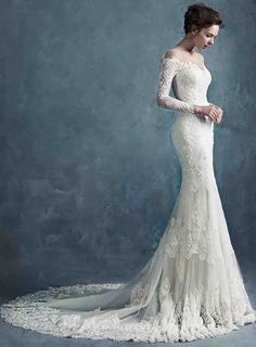 This is my perfect wedding dress design. Off the shoulder/boat neck, but with sleeves, trumpet/mermaid skirt, white