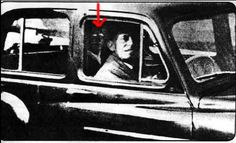 Picture above: Visiting the grave of her mother in 1959, Mrs. Mabel Chinnery took a photo of her husband waiting alone in the car. When the film was developed, the two were so surprised to see the figure in the backseat was her mother.