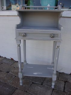Gotta love those polka dots on the knobs!  This nightstand was painted in Paris gray and then distressed.