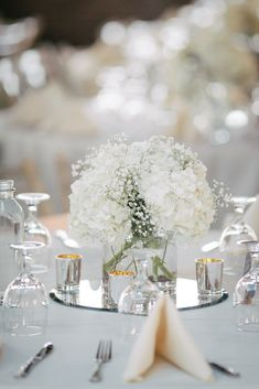 White Hydrangea and Baby's Breath Centerpieces | Erika Delgado Photography https://www.theknot.com/marketplace/erika-delgado-photography-fort-lauderdale-fl-439270