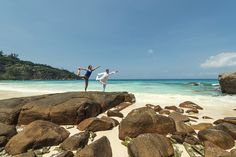 Yoga on the rocks at the Four Seasons Resort in the Seychelles