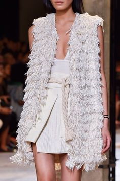 Isabel Marant Spring / Summer 2015 wonderful pulled knit white vest and spring whites