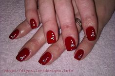DIY Nail Art Designs: Fiery Red Polish with Hand-Painted White hearts.