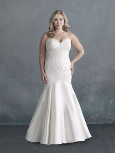 Achieving a gorgeous balancing act, this strapless gown pairs an ornate sweetheart bodice with a softy flared skirt.