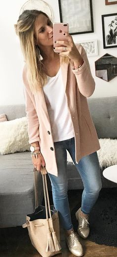 women's beige cardigan, white v-neck top and faded blue jeans