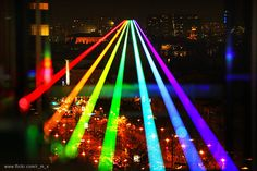 """""""Global Rainbow"""" by Yvette Mattern is a massive scale outdoor light projection in which seven high power lasers project a rainbow light beam for up to five miles. The projection was originally displayed in New York in 2009, and is currently on tour through the United Kingdom in celebration of the 2012 Cultural Olympiad."""