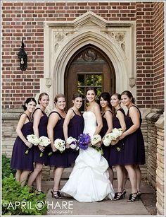 Purple bridesmaid dresses and white flowers