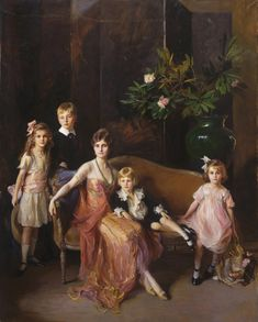 """Philip A. de László, """"Portrait of Mrs. Francis P. Garvan and Her Four Children,"""" 1921, at the Philadelphia Museum of Art. Mrs. Garvan (née Mabel Brady) is seen wearing a gown designed by Harry Collins that is also located at the PMA."""