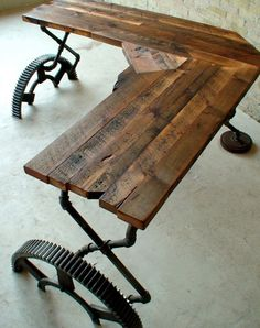 Rough cut corner desk with reclaimed gears and pipes by Jordan Waraksa.