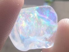I love <3 <3 this opal! Shiny and bright with an array of neon pastels.