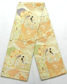 """This is a vintage Maru obi with flowers such as 'Ume'(Plum blossoms) and """"Fuji"""" (wisteria), 'tsuzumi'(Japanese drum) on 'Tagasode'(design of kimono or sleeves) pattern, which is woven"""