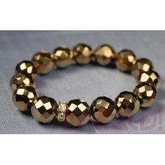 Pulsera realizada con bolas talladas de 12mm, cristal checo color dorado marrón,y un rondelle de cristal Swarovski.