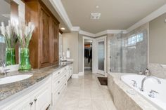 Now this is what I call an ensuite bathroom! What you do not see in this pic is the 3 sided fireplace that separates the master bedroom from the ensuite !!  4488 Puget Dr Vancouver