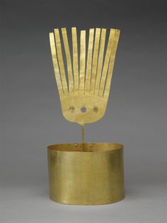 A gold crown (llauto) formed of a plain band with single riveted seam, fitted at the back with a plume with fringed upper section, the lower part with three pierced circles, two fitted with suspended discs. The crown was excavated in 1854 in Chordeleg in the Cuenca region of the highlands of Ecuador, approximately one hundred and eighty miles south of the capital Quito. The main ethnic group in the area were the Cañari who ruled a powerful confederation that was conquered by invading Inca…