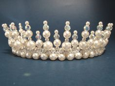 tiara measures 2 inches high and contains 4mm, 8mm, 10mm white glass pearls and 6mm machine cut Czech crystal.