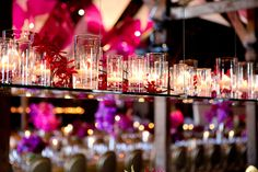 Floating candles and red orchids over kings tables with violet and pink centerpieces. Design by Waterlily Pond / Floral Artistry & Event Design / San Francisco, California. Photos courtesy of Larissa Clevelend Photography. Santa Lucia Preserve, Carmel Valley.