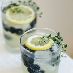 Limoncello prosecco with blueberries and thyme. The perfect summer cocktail.