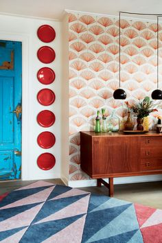 Fancy wallpaper and beautiful 1960s sideboard in the entryway