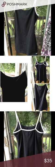 """NIKE SILKY ATHLETIC DRESS NIKE SPORTS DRESS. SILKY AND BREATHABLE, WICKS AWAY SWEAT. HAS A BUILT IN BRA AS SEEN IN LAST PICTURE. Perfect for tennis, working out, bathing suit cover, or for everyday dressing on a hot day. MACHINE  WASH WARM, GENTLE CYCLE, TUMBLE DRY LOW. 92% Polyester, 8% Lycra Spandex   LENGTH IS 30"""" from top of dress to the bottom. Measuring across from armpit to armpit is 14"""". Stretchy material. The Nike logo at the bottom is starting to crack from washing and drying, but…"""