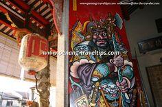 A menacing door god peers at visitors to Tan Kongsi
