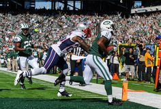 Wide receiver Jeremy Kerley #11 of the New York Jets catches a pass for a touchdown during the 1st quarter against the New England Patriots ...