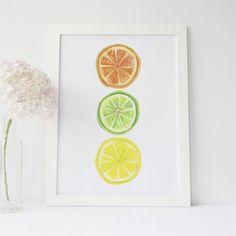 Add a little flair to your kitchen or home decor with this citrus fruit art print. It features slices of a lemon, lime and orange -- all painted in watercolors by hand.