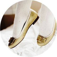 Gold Flats with white tights.