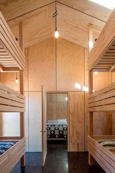 Cardrona Hut - RTA Studio New Zealand Architecture, Interior Architecture, Interior Design, Stone Chimney, Wooden Shutters, Timber Cladding, Custom Sofa, Large Windows, Living Spaces