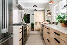 A Drab Galley Kitchen Gets A Modern Transformation At The Midwest Malibu Cottage. A Drab Galley Kitchen Gets A Modern Transformation At The Midwest Malibu Cottage - Front + Main City Kitchen Design, Living Room Goals, Narrow Kitchen, A Frame House, Workspace Design, Loft Spaces, Kitchen Decor, Kitchen Ideas, Kitchen Living