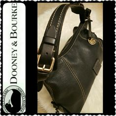 Dooney & Bourke Leather Bag Dooney & Bourke Signature All Leather Shoulder Bag, Classic Black with Silver Hardware, Dooney Logo Stitching Upfront  Approx Size 16 x 9 x 6 inches,  Adjustable Strap Handle, Zipper Top Main Closure with Zipped Pocket Inside, Fully Fabric Lined - Shows Wear on Inside, See Interior Pictures, Excellent Exterior, Open to Reasonable Offers Dooney & Bourke Bags Shoulder Bags