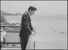 Elvis Arrives in Hawai'i for Benefit Concert: Elvis takes in the view of Hawai'i during his 1961 benefit concert for the USS Arizona Memorial.