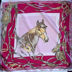 Length: 24.5 Inches; Width: 24.5 Inches  Description  This is an absolutely beautiful vintage scarf featuring a horse on a pink background. The scarf combines bright pink and hot pink colors that create a nice contrast. The edges of the scarf are decorated with equestrian ornament depicting horse saddles straps and buckles. This scarf is a true find for a horse lover. The writing on the tag is all washed away but I believe that the scarf was made in Italy. Even though the scarf was used… Tie Styles, Designer Scarves, Horse Saddles, Vintage Scarf, Neck Wrap, Square Scarf, Headband Hairstyles, Hair Ties, Bright Pink