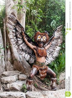 Photo about A Mayan Indian wearing an eagle costume in XCaret, Yucatan Peninsula, Mexico. Image of america, peninsula, mayan - 26566068 We Are The World, People Of The World, Mexico Tours, Peru, Chile, Free Stock, Inca, Mayan Ruins, World Cultures