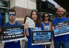 Zionist Union activists protest outside Israel Hayom headquarters in Tel Aviv. Photo By: MARC ISRAEL SELLEM/THE JERUSALEM POST
