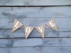 Love--- This LOVE banner makes a lovely decoration for any sweet occasion. Would lookgreat as a photo prop at your wedding. Made of natural burlap and super shiny white glitter for the letters. Comes with extra jute twine for tying. Burlap Bunting, Wedding Hire, Baby Family, Family Photography, Arrow Necklace, Banner, Glitter, Love, Unique Jewelry