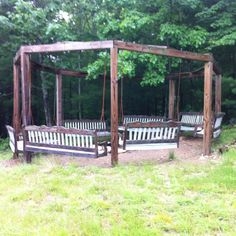 Swings around a firepit. Its an adult swingset.  I love swings!!  Love the idea!